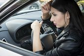 Side View Of Beautiful Young Woman Looking In Car Side-view Mirror Sitting In Vehicle. Female Driver poster