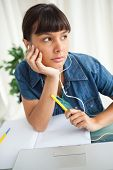 Female student demotivated to do her homework while listening music poster