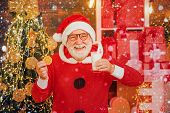 Santa Claus - Bearded Funny Senior. Santa In Home. Santa Claus Eating Cookies And Drinking Milk On C poster