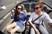 picture of seatbelt  - Young couple in dark sunglasses - JPG
