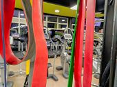 Red Elastic Bands In A Modern And Well Equipped Gym For Getting Fit And Exercise Stretching And Flex poster
