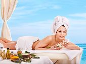 Young woman getting spa lastone therapy outdoor. poster