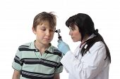 stock photo of speculum  - A doctor uses an otoscope to examine a child - JPG
