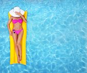 stock photo of legs air  - Woman relaxing in a pool - JPG