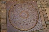 Copenhagen, Denmark: Copenhagen Manhole. Unusual Manhole On The Street In The City poster