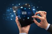 Businessman holding a foldable smartphone with SOCIAL MEDIA inscription, social networking concept poster