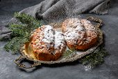 Traditional Stollen Sprinkled With Powdered Sugar. poster