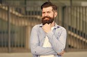 Pensive Hipster Thinking Pleasant Thoughts. Man Bearded Hipster Urban Background. Regular Walk In Ci poster
