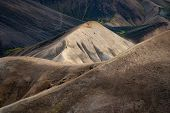 Man Walking On The Path On The Colorful Hill With Black Ash Ob Background In The Laugavegur Hiking T poster