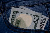 Banknotes, Money In A Jeans Pocket, Close Up. Money Stick Out Of The Jeans Pocket, Finance And Curre poster