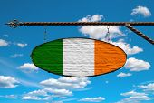 Ireland Flag On A Signboard. Oval Signboard Colors Ireland Flag Hanging On A Metal Forged Structure. poster