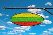 Lithuania Flag On A Signboard. Oval Signboard Colors Lithuania Flag Hanging On A Metal Forged Struct poster