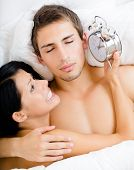 stock photo of nearly nude  - Close up of couple lying in bed - JPG