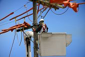 stock photo of lineman  - Linemen power utility - JPG