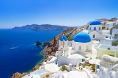 foto of greek  - White architecture of Oia village on Santorini island - JPG