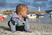 picture of st ives  - Toddler child boy on pebble seaside beach in the village port or harbour - JPG