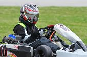 foto of karts  - Teenage racer on a sprint kart on a road racing circuit - JPG