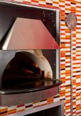 foto of pizza parlor  - View of commercial oven in a pizza parlor kitchen - JPG