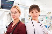 picture of intensive care unit  - Two young female doctors in intensive care unit - JPG