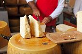BRA - SEPTEMBER 22: Cut pieces of Parmesan - famous italian hard cheese made from raw cow's milk, of