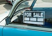 stock photo of yard sale  - for sale sign on a vintage car - JPG