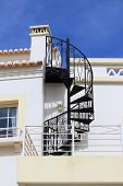 picture of twisty  - Abstract twisty iron staircase outside of a house in Algarve Portugal  - JPG
