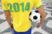 picture of ipanema  - Brazilian soccer player holding football wears 2014 shirt in Brazil colors Rio de Janeiro - JPG