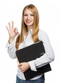 stock photo of chemise  - Young woman in business style with okay sign stands holding black folder isolated on white background - JPG