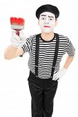 image of mime  - Mime artist holding a paintbrush isolated on white background - JPG