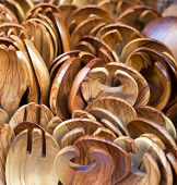 foto of memento  - Salad spoons and forks made of olive wood on sale as tourist mementoes in Greece - JPG