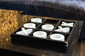 pic of tic-tac-toe  - Wooden Black and White Tic Tac Toe Game sits on a Coffee Table