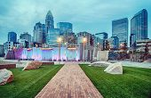 foto of highrises  - charlotte city skyline in the evening wiht cloudy sky - JPG