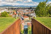 foto of descending  - Funicular descending with a panoramic view of a city Ljubljana Slovenia - JPG