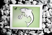 foto of loan-shark  - Loan shark doodle on digital tablet on crumpled paper - JPG