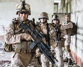 stock photo of assault-rifle  - Squad of US marines in ruined building - JPG