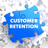 stock photo of enticing  - Customer Retention on Blue Puzzle on White Background - JPG