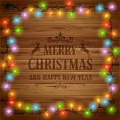 picture of glow  - Christmas festive background with glowing electric garland - JPG