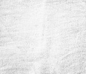 stock photo of cross-dressing  - Perspective and closeup view to abstract canvas of empty light gray and white natural clean gauze texture for the traditional business background with sparse threads and clear space for your own text - JPG