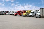 stock photo of truck-cabin  - Semi trucks parked together - JPG