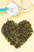 Постер, плакат: Green Tea Leaves Heart Shaped And Stethoscope