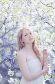stock photo of heartfelt  - Beautiful cute girl posing in a spring day - JPG
