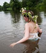 foto of undine  - Girl dressed in pareo and flower wreath in river - JPG