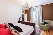 stock photo of master bedroom  - Vintage big master bedroom with wooden floor - JPG