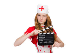 picture of witch-doctor  - Woman doctor in bloody uniform with movie clapperboard - JPG