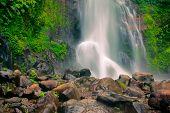 foto of breathtaking  - Gitgit waterfall is one of the talest and most breathtaking waterfalls in Bali Indoensia - JPG