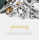 stock photo of plumbing  - plumbing and tools on a light background - JPG