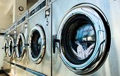 foto of laundry  - line of laundry machine in shop during business time - JPG