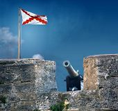 stock photo of frot  - frot wall with canon and spanish flag at Fort Cas De San - JPG