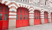 picture of fire-station  - Beautiful accented brickwork facade and bright red painted garage doors of a fire station in Singapore - JPG