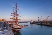 foto of tall ship  - A tall ship on Poole Quay with boats and cranes of the working port in the background - JPG